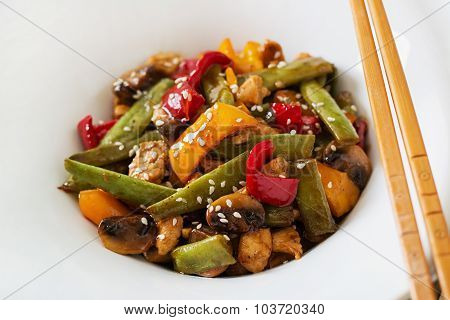 Stir fry with chicken, mushrooms, green beans and sweet peppers.