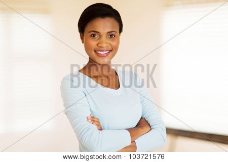 beautiful african woman with arms crossed at home
