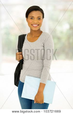 beautiful female african university student indoors