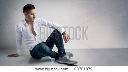 Vogue style of young man resting on floor