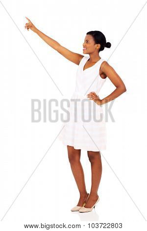 beautiful black woman pointing at empty space isolated on white