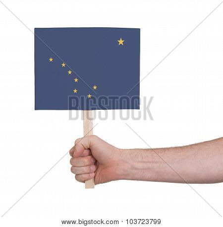 Hand Holding Small Card - Flag Of Alaska