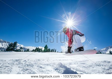 Snowboarder in jump over beautiful  blue sky