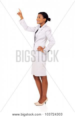 attractive african businesswoman pointing at empty copy space on white background