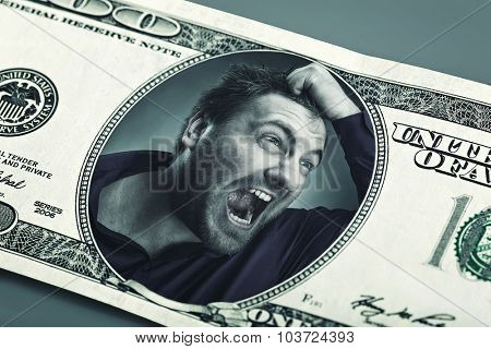 Angry man in the dollar banknote