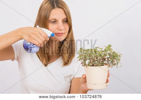Girl Watering A Flower From The Sprinkler Home