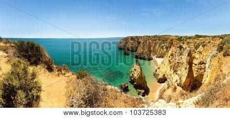 Ocean with sandy cliffs