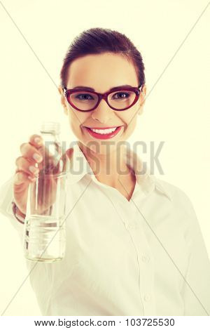 Portrait woman with bottle of water.