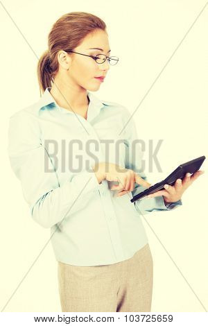 Beautiful bank employee with pocket calculator.