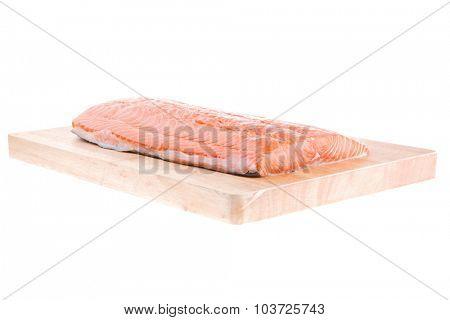 fresh raw salmon fillet on wood over white