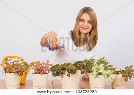 She Sprinkles Water From The Sprinkler Flowers