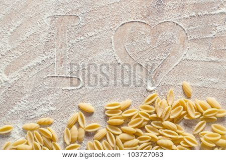 I love pasta. Concept with pasta and flour.