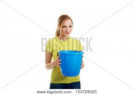 Young student woman holding blue bucket.