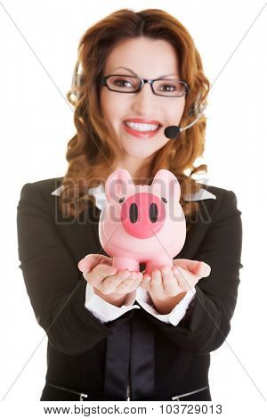 Happy beautiful call center woman with piggy bank.