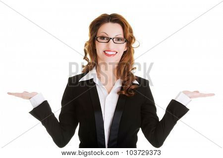 Happy business woman with open hands to present copyspace.