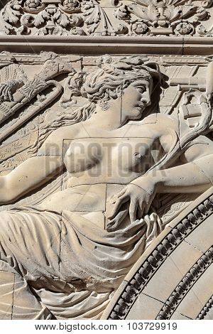 PARIS, FRANCE - SEPTEMBER 9, 2014: Paris - Architectural fragments of Triumphal Arch (Arc de Triomphe du Carrousel) at Tuileries. Tuileries Garden - public garden located between Louvre and Concorde Place. It was opened in 1667. Paris France