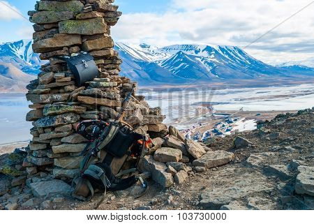 Rifle And Snow Shoes Overlooking Longyearbyen City, Svalbard