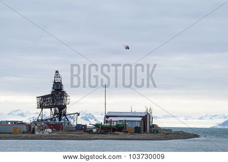 Helicopter Flying Over The Port In Longyearbyen, Svalbard