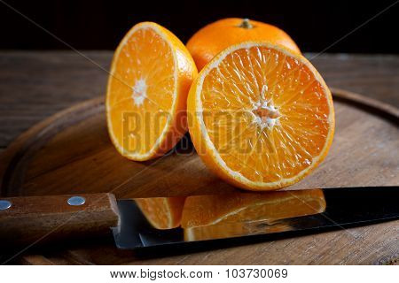 Tangerine Cut On An Old Table Closeup