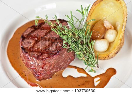 grilled beef steak with herbs and vegetables