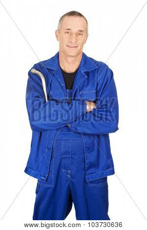 Mature repairman holding his wrench.