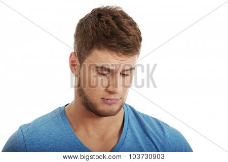 Handsome young caucasian depressed man.