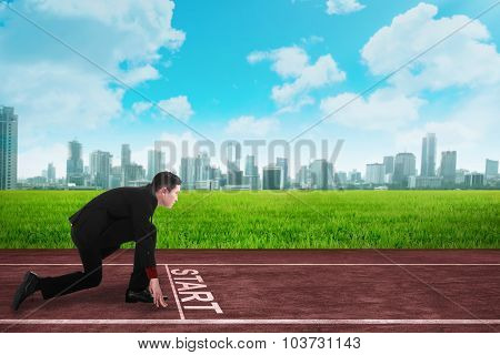 Business Person  In Ready Position To Race On The Track
