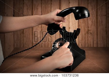 Hand Holding Telephone And Dialing Number
