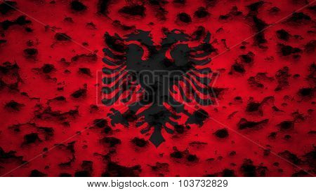 Flag of Albania, Albanian Flag painted on wall with bullet holes.