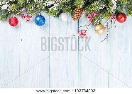 Christmas wooden background with snow fir tree and decor. View with copy space