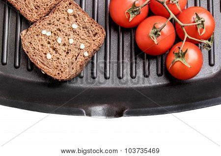 Fresh Bread And Cherry Tomatoes On A Grill Pan