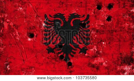 Flag of Albania, Albanian Flag painted on metal texture with bullet holes