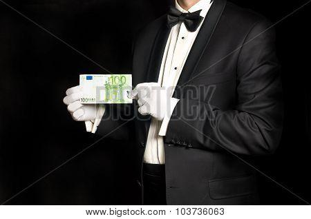 Elegant Man In Tuxedo Holding 100 Euro Banknote