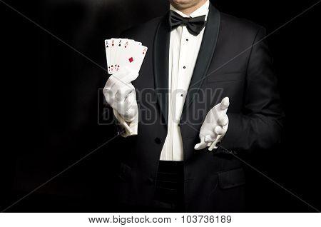 Elegant Man In Tuxedo Holding 4 Aces In Hand