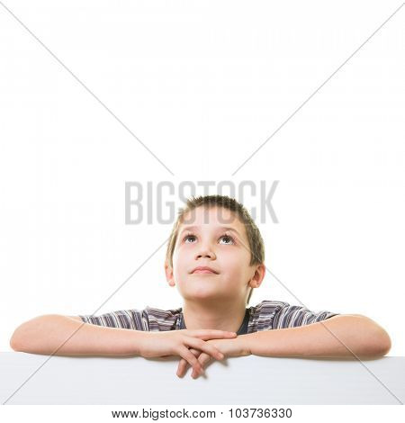 Cute little boy looking up towards blank/empty space (room for your graphics)