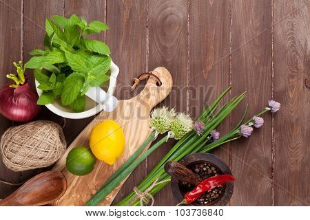 Fresh herbs and spices on garden table. Top view with copy space