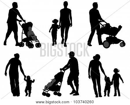 parents walking with their children silhouettes