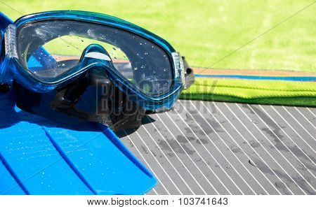 Wet Mask And Scuba Fins On A Towel