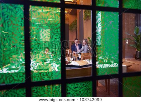 business people meeting in modern restaurant, romantic couple having dinner and take drink after work