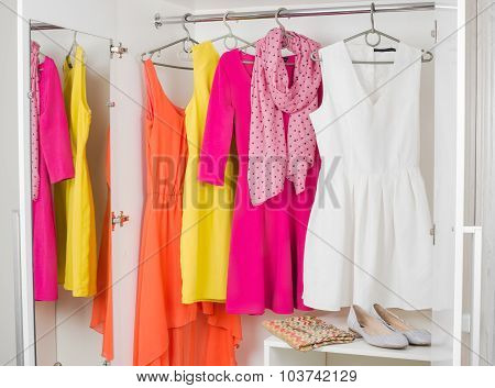 Row Of Bright Colorful Dress Hanging