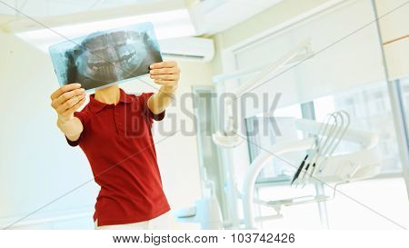 doctor or dentist looking at x-ray