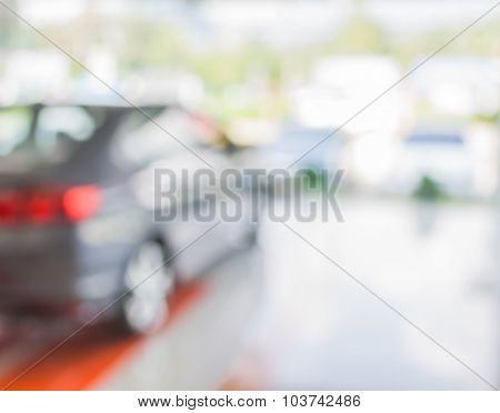 Blur Image Of Commercially Cars Stand
