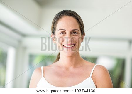 Portrait of happy pregnant woman standing at home