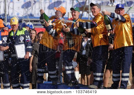 NOVOPRIOZERSK HIGHWAY, LENINGRAD OBLAST, RUSSIA - SEPTEMBER 11, 2015: Winners with prizes celebrate during award ceremony of the final part of Worldskills Russia championship of road workers