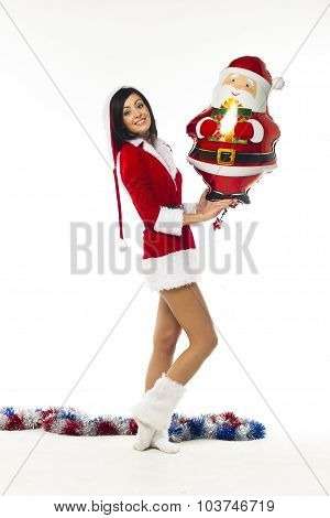Beautiful Young Woman Dressed As Santa Claus On A White Background, Emotional, Cheerful, Cheerful. H