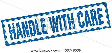 Handle With Care Blue Square Grunge Stamp On White