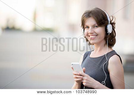 Smiling Female Listening Music Online