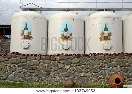 Kvareli, Georgia-March,3 2015: Three big cisterns with wine on Kinzmarauli Corporation in Kvareli. G