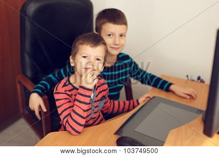 Little Boys Using Computer At Home