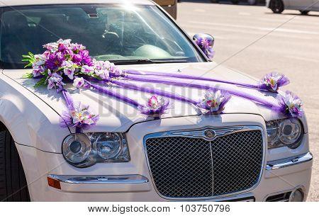 Beautiful Flowers Lay On The Hood Of Wedding Car
